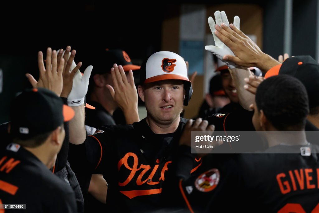 Mark Trumbo #45 of the Baltimore Orioles celebrates in the dugout after hitting a two run home run against the Chicago Cubs in the eighth inning at Oriole Park at Camden Yards on July 14, 2017 in Baltimore, Maryland.