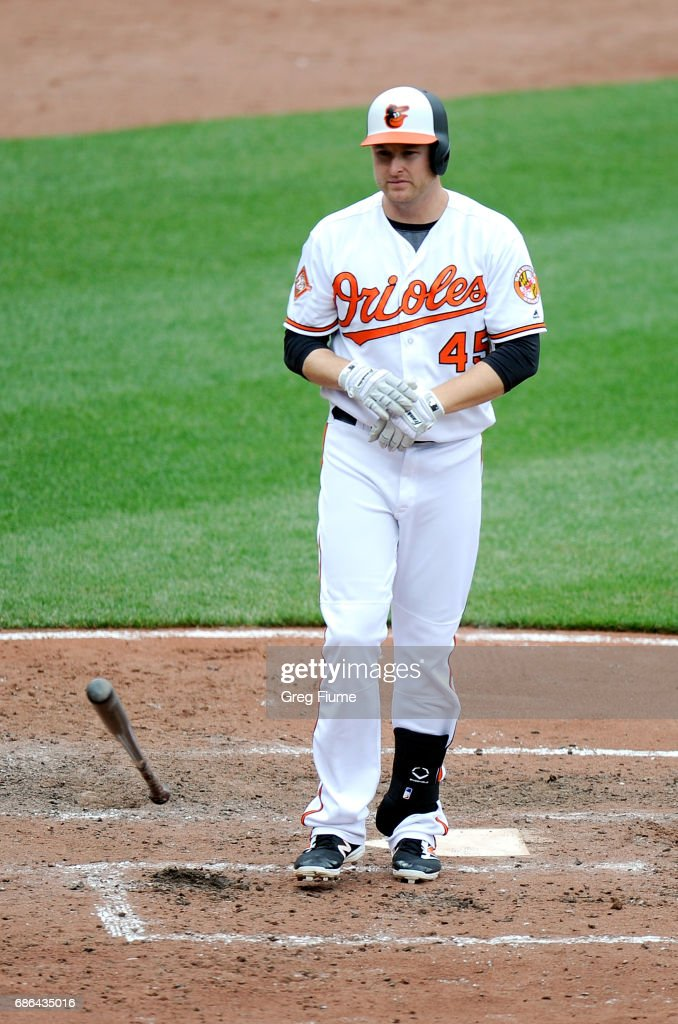 Mark Trumbo #45 of the Baltimore Orioles flips his bat after striking out in the sixth inning against the Toronto Blue Jays at Oriole Park at Camden Yards on May 21, 2017 in Baltimore, Maryland.