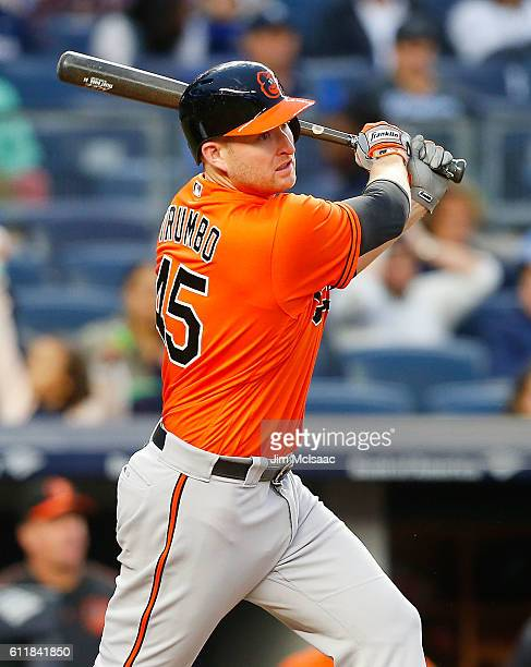 Mark Trumbo of the Baltimore Orioles follows through on a seventh inning base hit against the New York Yankees at Yankee Stadium on October 1 2016 in...