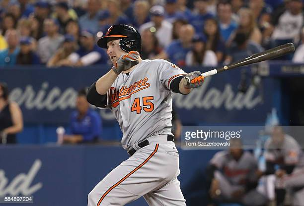 Mark Trumbo of the Baltimore Orioles hits a double in the seventh inning during MLB game action against the Toronto Blue Jays on July 31 2016 at...