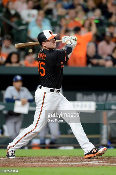 Mark Trumbo of the Baltimore Orioles hits a home run in the seventh inning against the Tampa Bay Rays at Oriole Park at Camden Yards on May 11 2018...