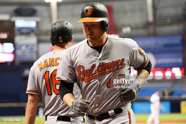 Mark Trumbo of the Baltimore Orioles hits a homer in the fourth inning against the Tampa Bay Rays on August 8, 2018 at Tropicana Field in St...