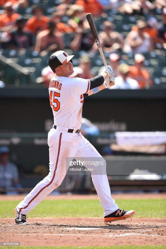 Mark Trumbo #45 of the Baltimore Orioles hits a solo home run in seventh inning during a baseball game against the Miami Marlins at Oriole Park at Camden Yards on June 17, 2018 in Baltimore, Maryland.