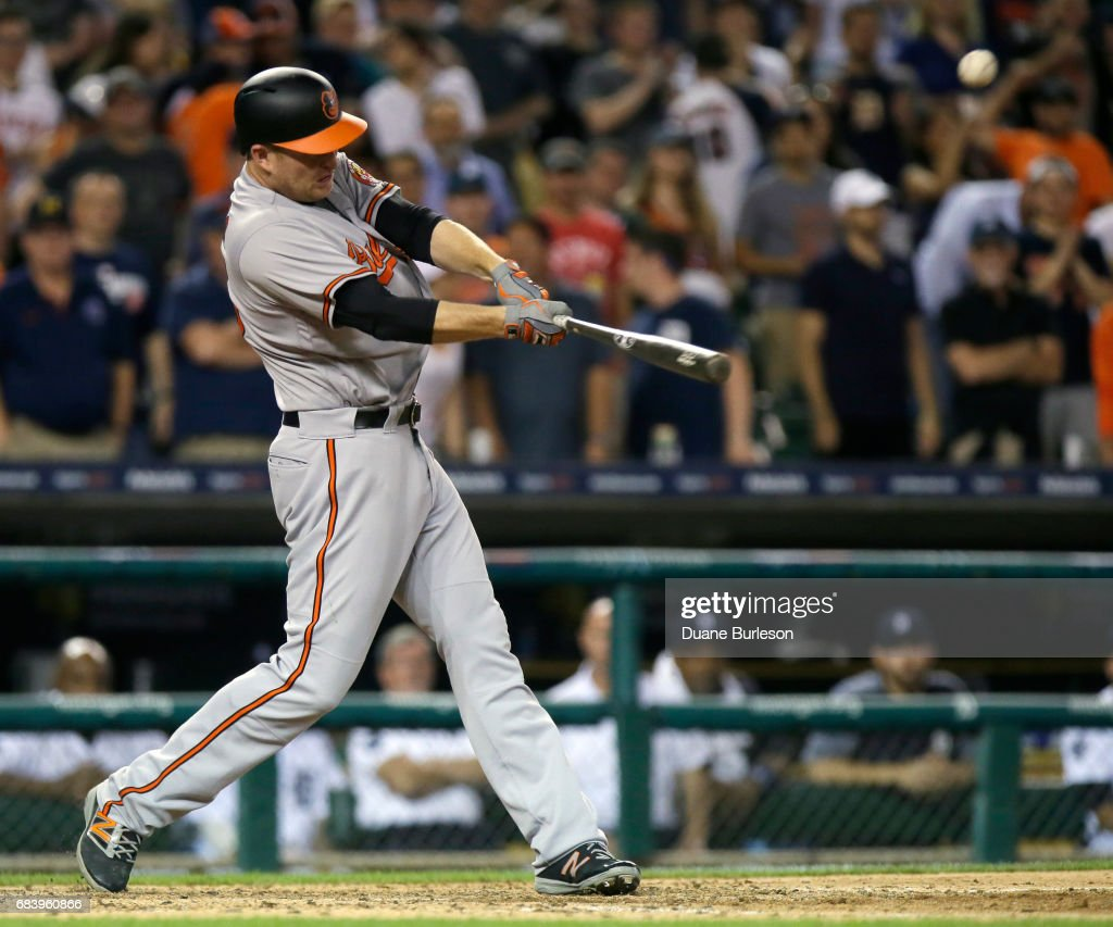 Mark Trumbo #45 of the Baltimore Orioles hits a solo home run to tie the game against the Detroit Tigers at 8-8 during the ninth inning at Comerica Park on May 16, 2017 in Detroit, Michigan.