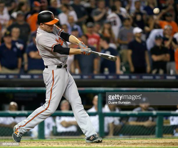 Mark Trumbo of the Baltimore Orioles hits a solo home run to tie the game against the Detroit Tigers at 88 during the ninth inning at Comerica Park...