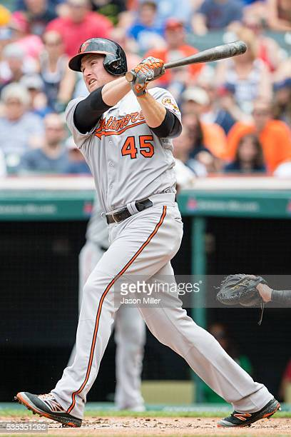 Mark Trumbo of the Baltimore Orioles hits a three run RBI double during the first inning against the Cleveland Indians at Progressive Field on May 29...