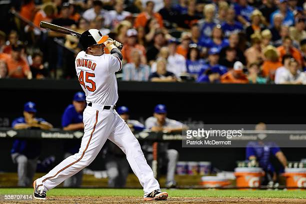 Mark Trumbo of the Baltimore Orioles hits a tworun home run against the Kansas City Royals in the fifth inning during a MLB baseball game at Oriole...