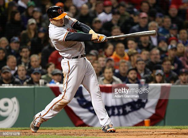 Mark Trumbo of the Baltimore Orioles hits a tworun home run in the sixth inning during the game against the Boston Red Sox at Fenway Park on April 12...