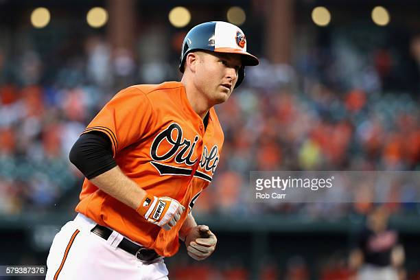 Mark Trumbo of the Baltimore Orioles rounds the bases after hitting a two RBI home run against the Cleveland Indians in the first inning at Oriole...