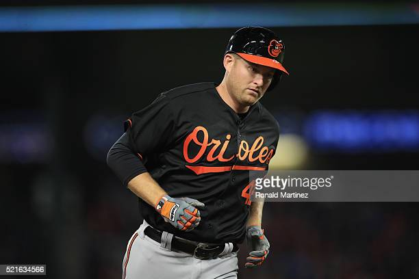 Mark Trumbo of the Baltimore Orioles runs the bases after a homerun against the Texas Rangers in the seventh inning at Globe Life Park in Arlington...