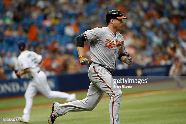 Mark Trumbo of the Baltimore Orioles sprints for first base after hitting an RBI single to score Chris Davis during the fifth inning of a game...
