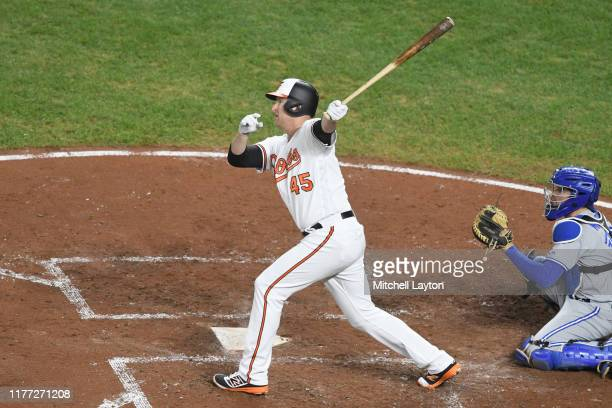 Mark Trumbo of the Baltimore Orioles takes a swing during a baseball game against the Toronto Blue Jays at Oriole Park at Camden Yards on September...