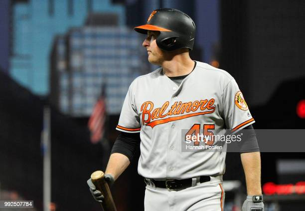 Mark Trumbo of the Baltimore Orioles walks to the dugout after striking out against the Minnesota Twins during the eighth inning of the game on July...