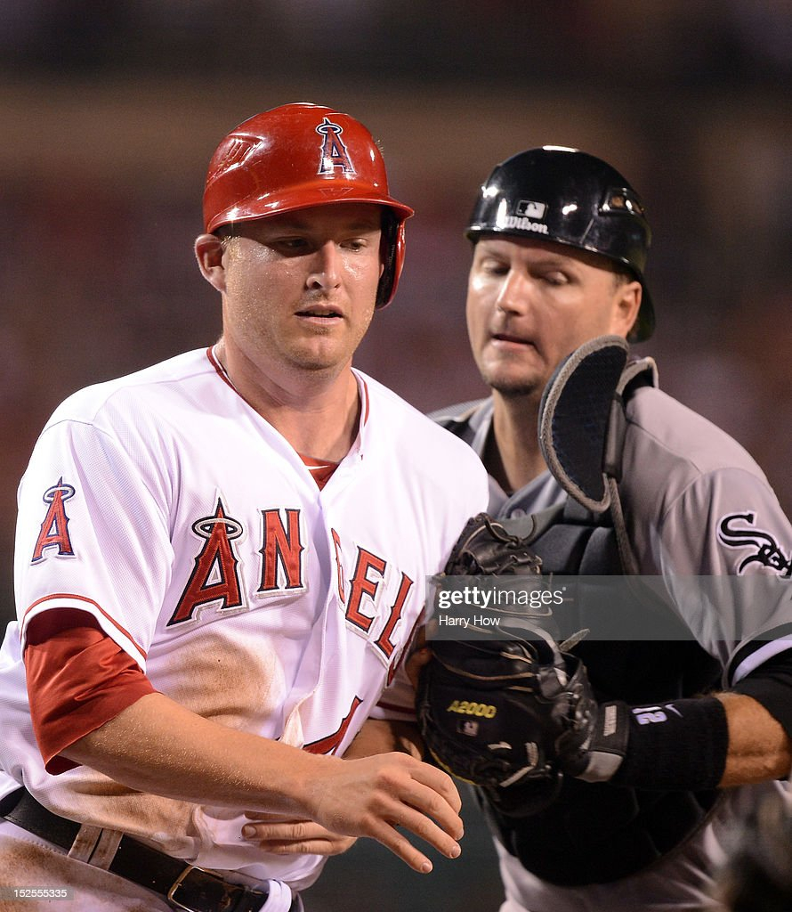 Mark Trumbo #44 of the Los Angeles Angels is tagged out in a run down by A.J. Pierzynski #12 of the Chicago White Sox during the second inning at Angel Stadium of Anaheim on September 21, 2012 in Anaheim, California.