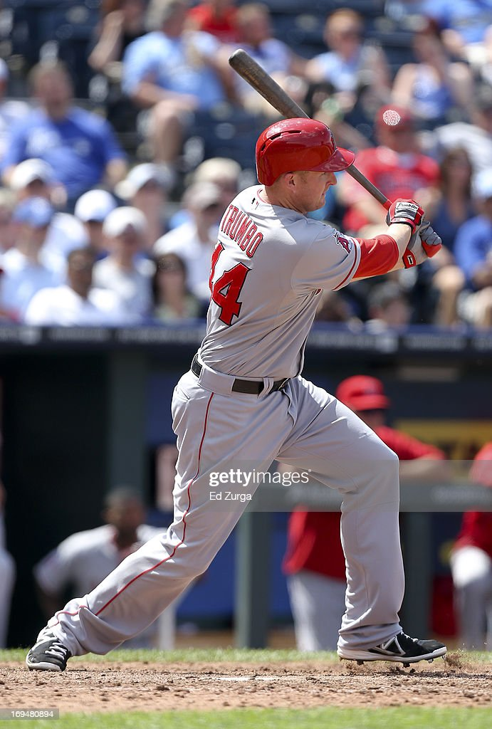 Mark Trumbo #44 of the Los Angeles Angels of Anaheim hits a two-run single in the eighth inning during a game against the Kansas City Royals at Kauffman Stadium on May 25, 2013 in Kansas City, Missouri.