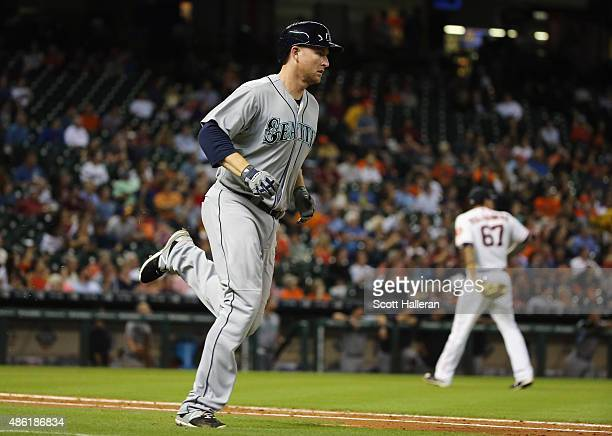Mark Trumbo of the Seattle Mariners rounds the bases after his tworun home run in the fifth inning off Vincent Velasquez of the Houston Astros during...