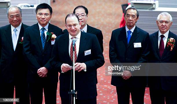 Mark Tucker chief executive officer of AIA Group Ltd third from left speaks during a listing ceremony for AIA Group at the stock exchange in Hong...