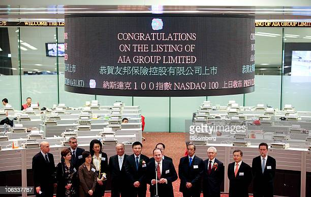 Mark Tucker chief executive officer of AIA Ltd eigth from left speaks during a listing ceremony for AIA Group Ltd at the Hong Kong stock exchange in...