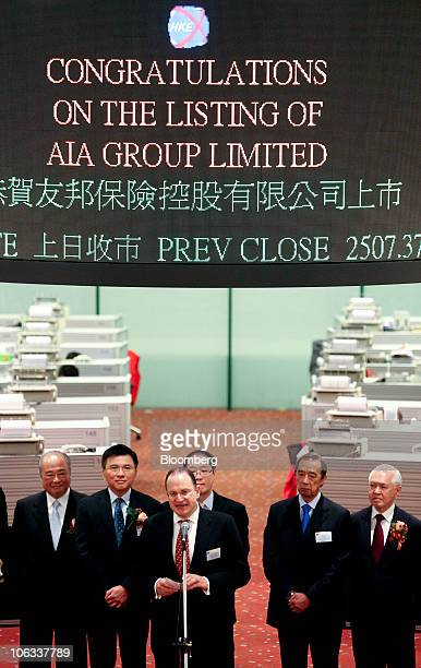 Mark Tucker chief executive officer of AIA Ltd third from left speaks during a listing ceremony for AIA Group Ltd at the Hong Kong stock exchange in...