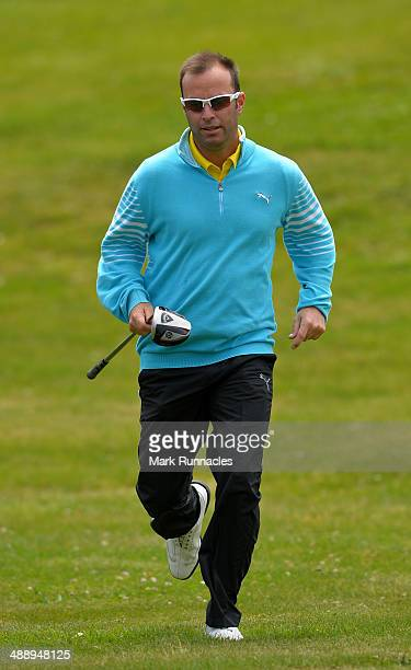 Mark Tullo of Argentina jogs to the 16th tee during the Madeira Islands Open Portugal BPI at Club de Golf do Santo da Serra on May 9 2014 in Funchal...