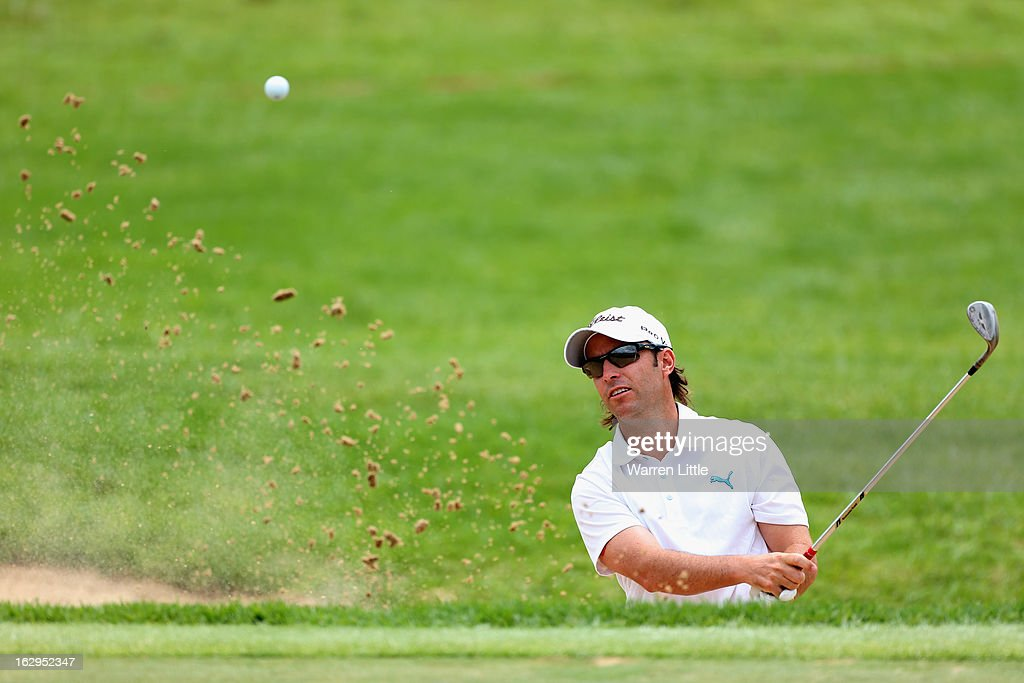 Mark Tullo of Chile plays out of the first greenside bunker during the third round of the Tshwane Open at Copperleaf Golf & Country Estate on March 2, 2013 in Centurion, South Africa.