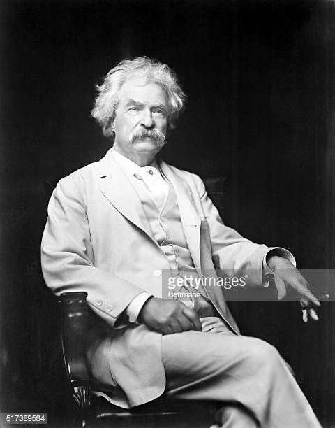 Mark Twain 18851910 lecturer and author of great literature In this 3/4 length photograph he's seated holding a cigar in a white suit Undated