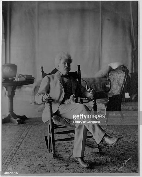 Mark Twain Holding Cat on Lap