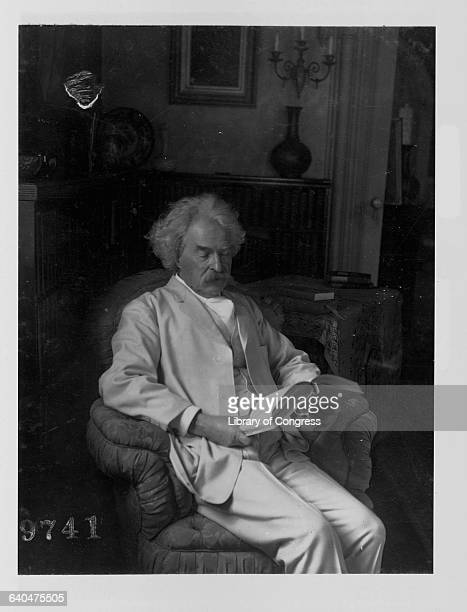 Mark Twain Reading a Book in His Living Room