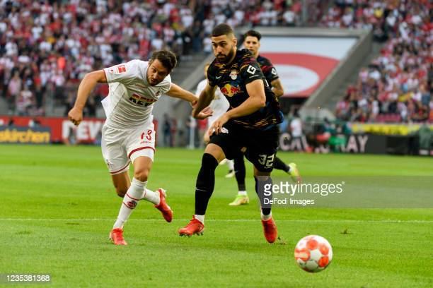 Mark Uth of 1. FC Koeln and Josko Gvardiol of RB Leipzig battle for the ball during the Bundesliga match between 1. FC Koeln and RB Leipzig at...