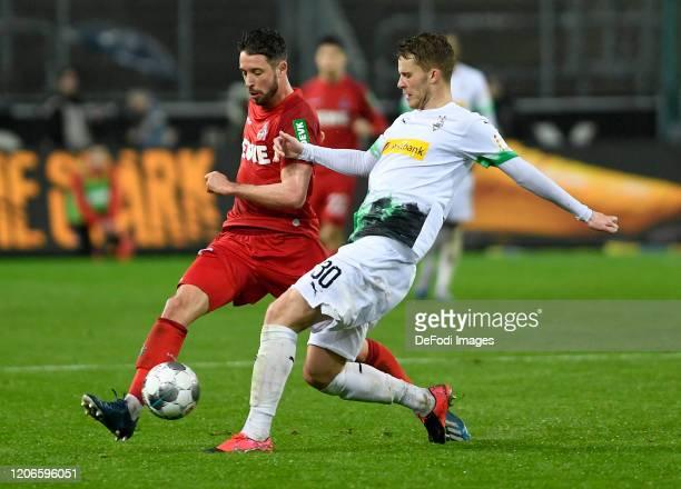 Mark Uth of 1 FC Koeln and Nico Elvedi of Borussia Moenchengladbach battle for the ball during the Bundesliga match between Borussia Moenchengladbach...