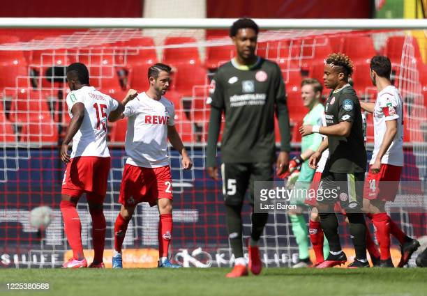 Mark Uth of 1. FC Koeln celebrates with his teammate John Cordoba of 1. FC Koeln after scoring his team's first goal by penalty during the Bundesliga...