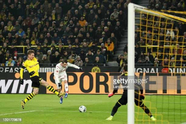 Mark Uth of 1 FC Koeln scores his sides first goal during the Bundesliga match between Borussia Dortmund and 1 FC Koeln at Signal Iduna Park on...