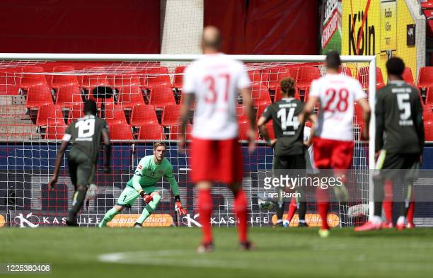 Mark Uth of 1. FC Koeln scores his team's first goal by penalty during the Bundesliga match between 1. FC Koeln and 1. FSV Mainz 05 at...