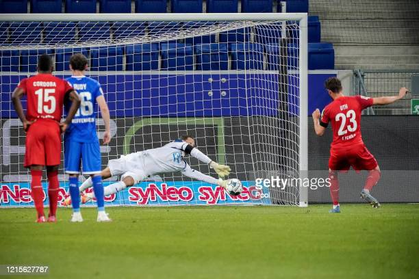 Mark Uth of Cologne fails a penalty kick against Hoffenheim's goalkeeper Oliver Baumann during the Bundesliga match between TSG 1899 Hoffenheim and...