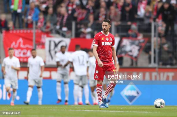 Mark Uth of FC Koln reacts as Robert Lewandowski of FC Bayern Muenchen scores his sides first goal during the Bundesliga match between 1 FC Koeln and...