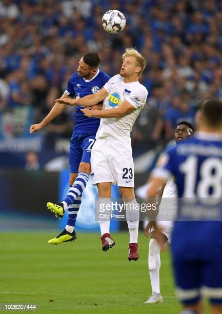 Mark Uth of FC Schalke 04 and Arne Maier of Hertha BSC during the game between Schalke 04 and Hertha BSC at the Veltins Arena on september 2 2018 in...