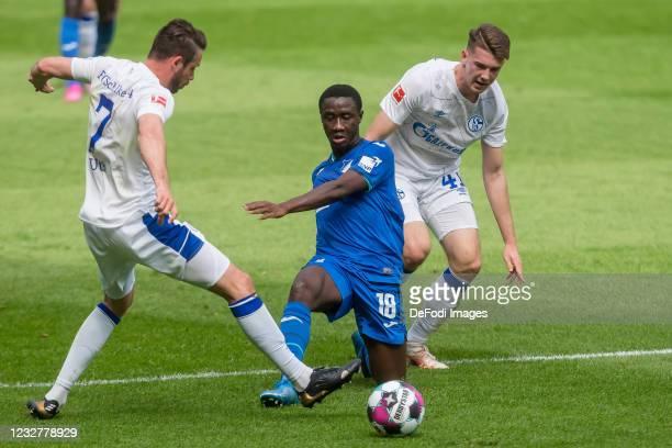 Mark Uth of FC Schalke 04, Diadie Samassekou of TSG 1899 Hoffenheim and Florian Flick of FC Schalke 04 battle for the ball during the Bundesliga...