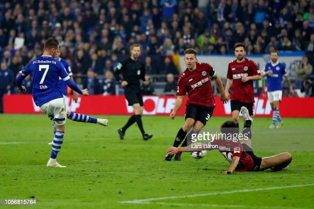 Mark Uth of FC Schalke 04 scores his team's third goal during the Bundesliga match between FC Schalke 04 and Hannover 96 at VeltinsArena on November...