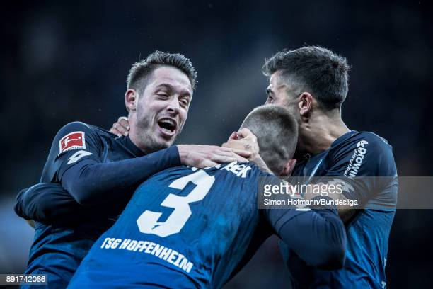 Mark Uth of Hoffenheim celebrates a goal with team mates Pavel Kaderabek and Kerem Demirbay during the Bundesliga match between TSG 1899 Hoffenheim...