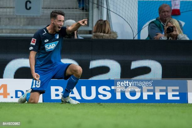 Mark Uth of Hoffenheim celebrates his team's first goal during the Bundesliga match between TSG 1899 Hoffenheim and FC Bayern Muenchen at Wirsol...