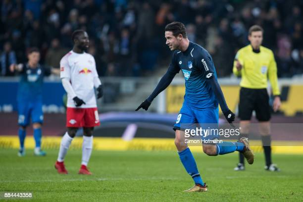 Mark Uth of Hoffenheim celebrates his team's fourth goal during the Bundesliga match between TSG 1899 Hoffenheim and RB Leipzig at Wirsol...