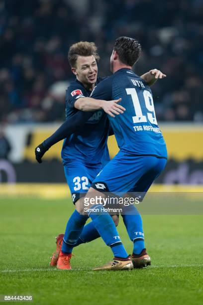 Mark Uth of Hoffenheim celebrates his team's fourth goal with team mate Dennis Geiger during the Bundesliga match between TSG 1899 Hoffenheim and RB...