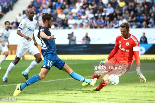Mark Uth of Hoffenheim misses a chance against Ralf Faehrmann of Schalke during the Bundesliga match between TSG 1899 Hoffenheim and FC Schalke 04 at...