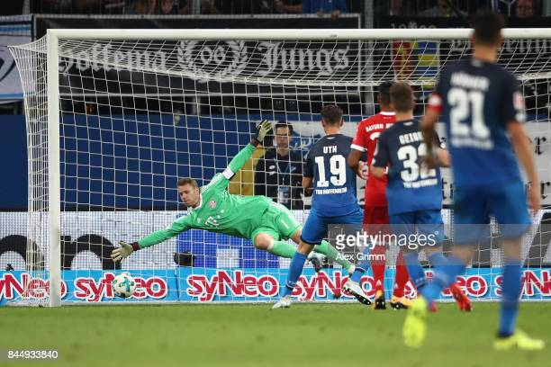 Mark Uth of Hoffenheim scored his teams second goal to make it 20 past goalkeeper Manuel Neuer of Bayern Muenchen during the Bundesliga match between...
