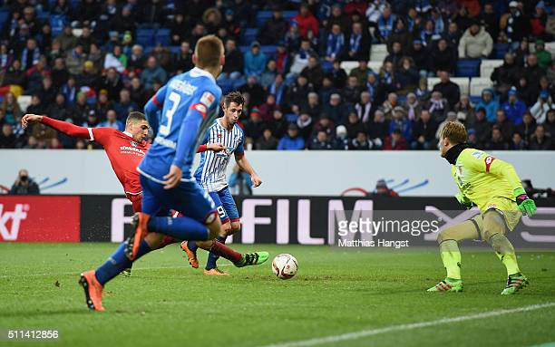 Mark Uth of Hoffenheim scores his team's third goal past goalkeeper Loris Karius of Mainz during the Bundesliga match between 1899 Hoffenheim and 1...