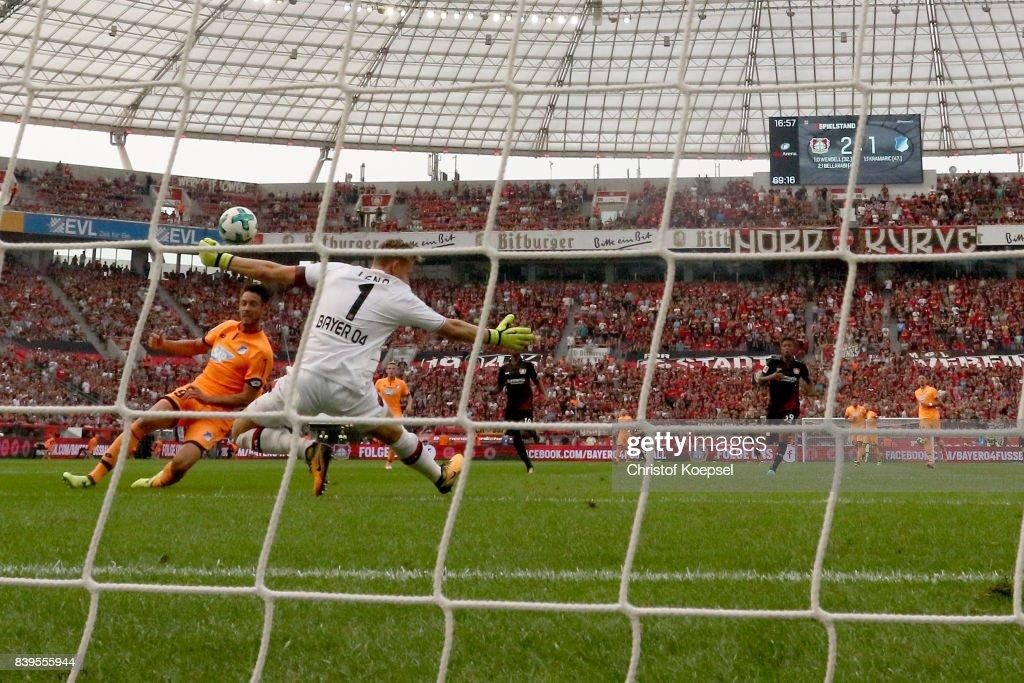 Mark Uth of Hoffenheim (L) scores the second goal against Bernd Leno of Leverkusen during the Bundesliga match between Bayer 04 Leverkusen and TSG 1899 Hoffenheim at BayArena on August 26, 2017 in Leverkusen, Germany.