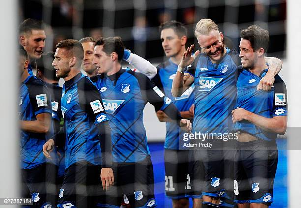 Mark Uth of TSG 1899 Hoffenheim is congratulated by Kevin Vogt after scoring the fourth goal during the Bundesliga match between TSG 1899 Hoffenheim...