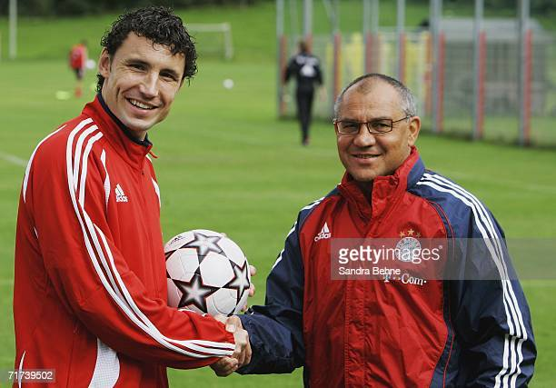 Mark van Bommel and coach Felix Magath shake hands during the Bayern Munich Training Session at Bayern's training ground Saebener Strasse on August...
