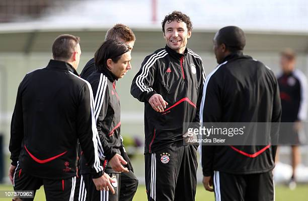 Mark van Bommel chats with Franck Ribery during a Bayern Muenchen training session ahead of the Champions League Group E match against FC Basel on...