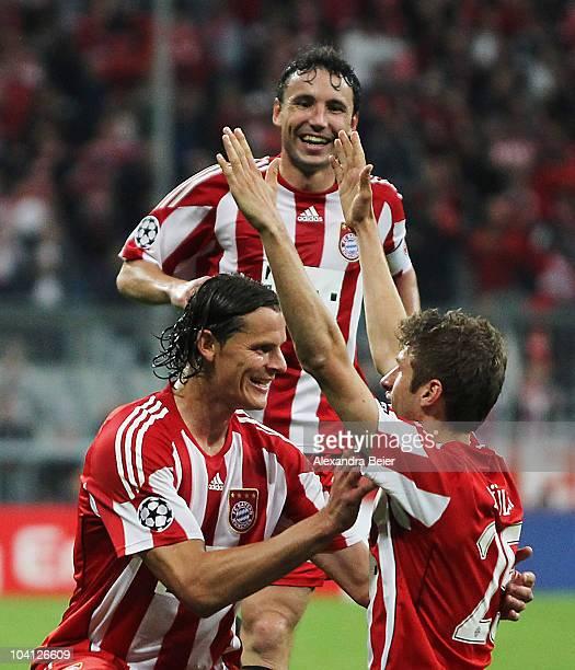 Mark van Bommel Daniel van Buyten and Thomas Mueller of Bayern celebrate Mueller's first goal during the UEFA Champions League group E match between...